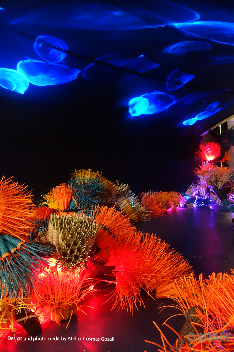 The installation and the virtual jellyfish project on the ceiling to create a underwater sea life environment